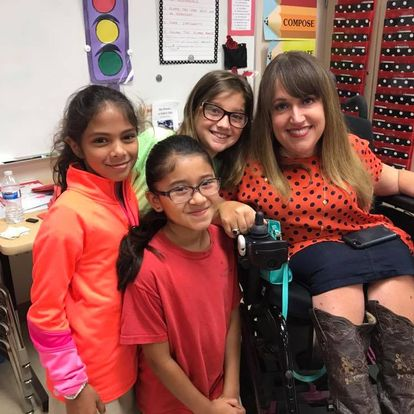 Angela Wrigglesworth pictured with some of her students is featured on this episode of Situation Positive.